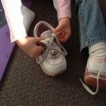 413151_girl_tying_shoe