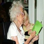 801960_reading_with_grandmother_in_wheelchair